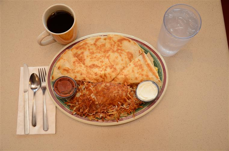 quesadilla with hash browns, water and coffee