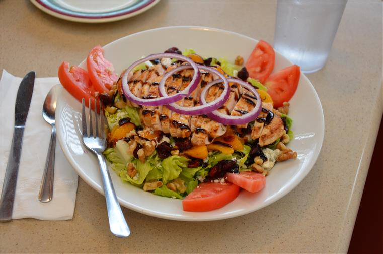 large garden salad with chicken slices and vegetables