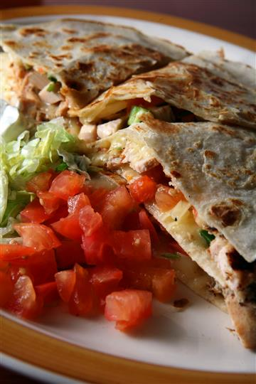 Quesadilla with a side of lettuce and tomatoes