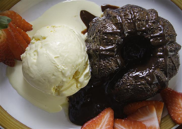Chocolate cake with a side of vanilla ice cream