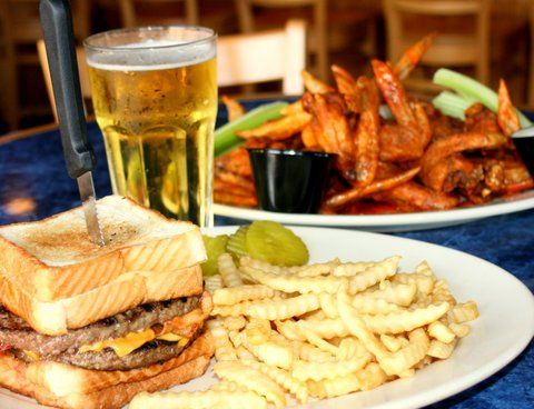 Double cheese burger in sandwich bread with French fries and wings