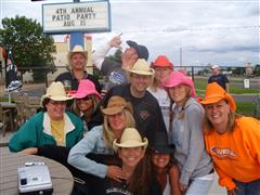 People standing with cowboy hats