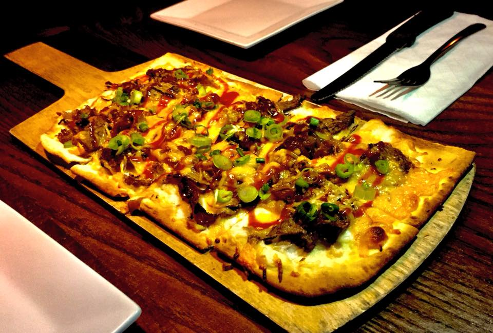 Pulled pork flatbread with BBQ sauce and green onions