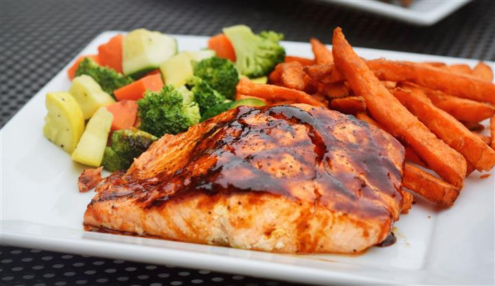Teriyaki salmon with sweet potato fries and steamed veggies