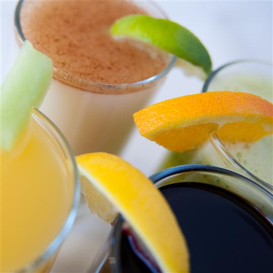 several smoothies in glasses