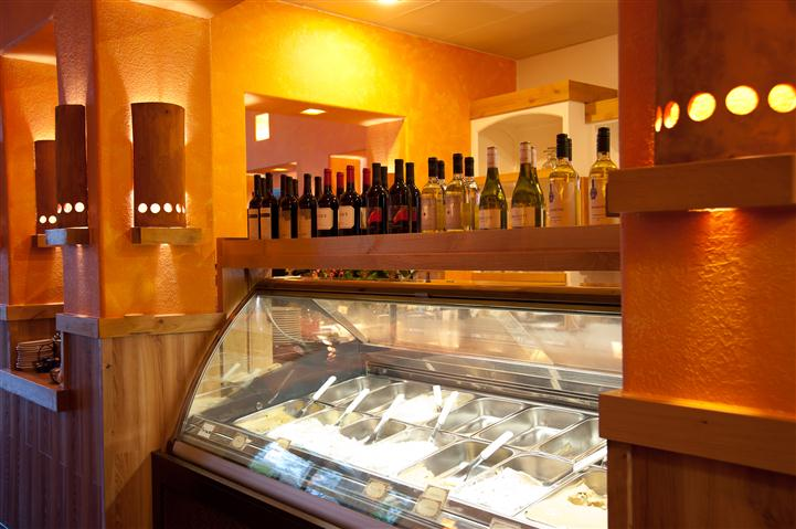counter topped with wine bottles