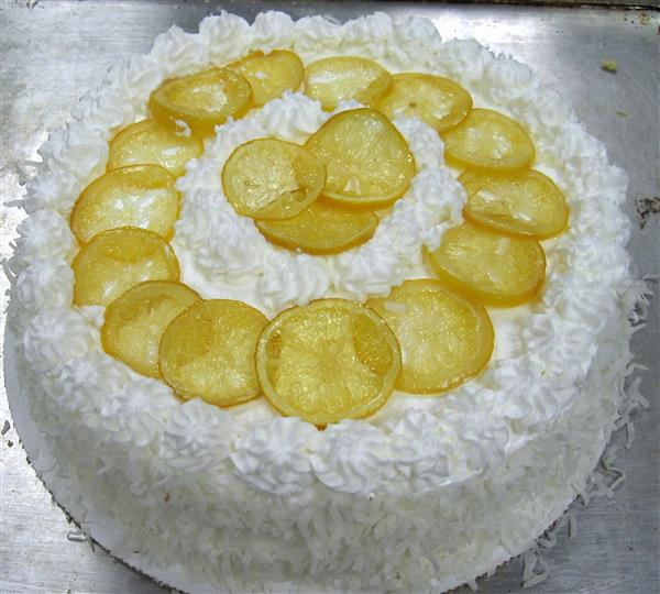 cake topped with lemon wedges
