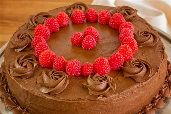 chocolate cake topped with raspberries
