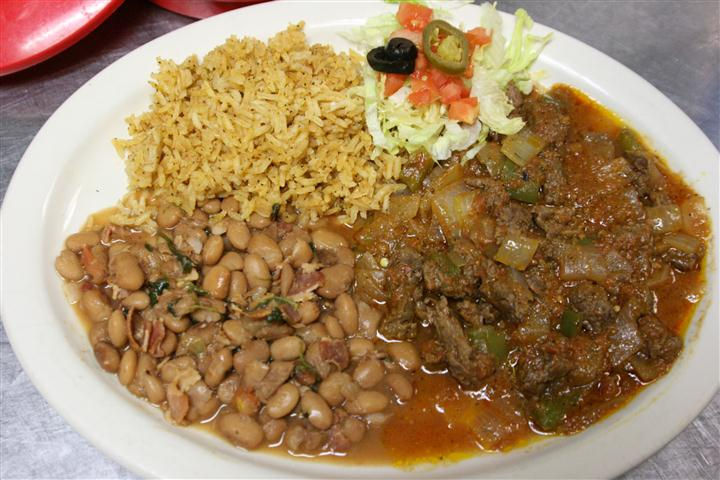 a plate with beef, beans and rice