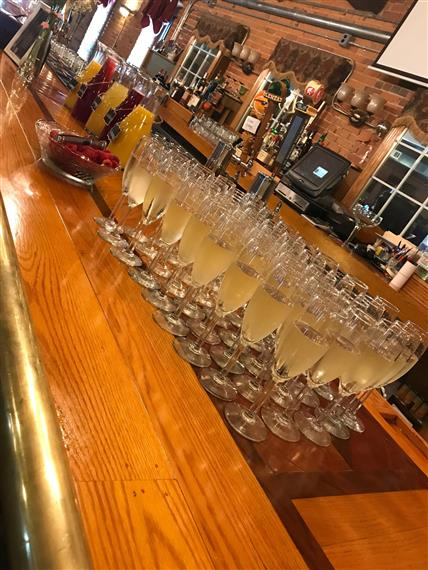 flutes of champagne set up on the bar ready for an event