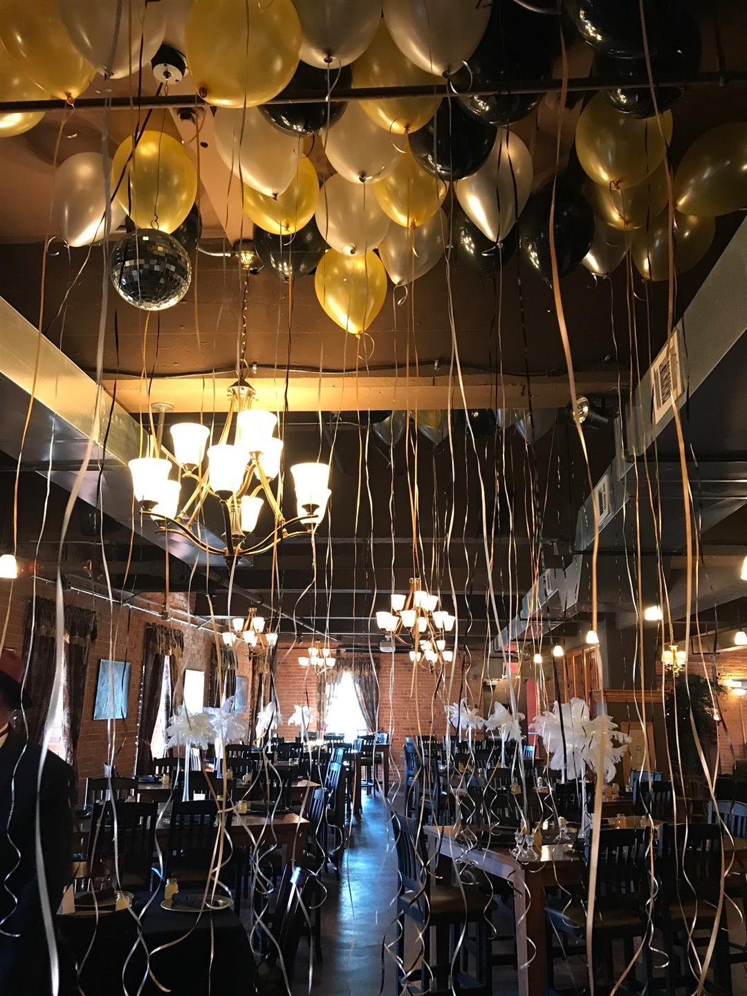 the ceiling with multiple balloons floating at the top