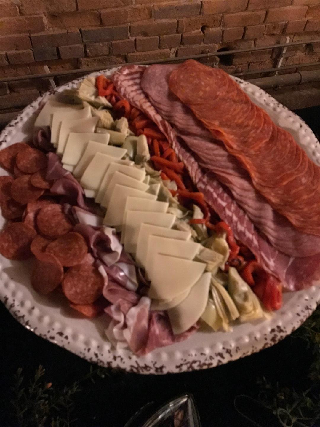 a plate with a variety of cheeses and meats