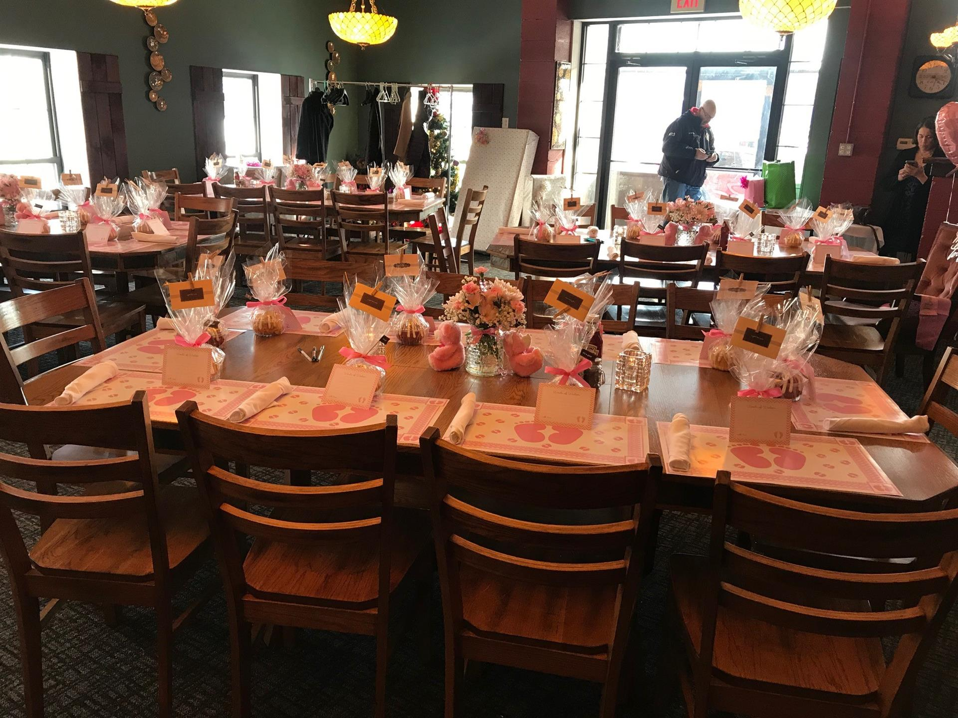 private dining tables with flower center pieces and goodie bags for each guest