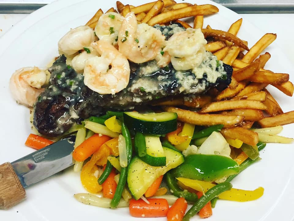 surf n turf includes a 12 oz. NY Strip Steak with Shrimp sautéed in a savory shrimp scampi sauce