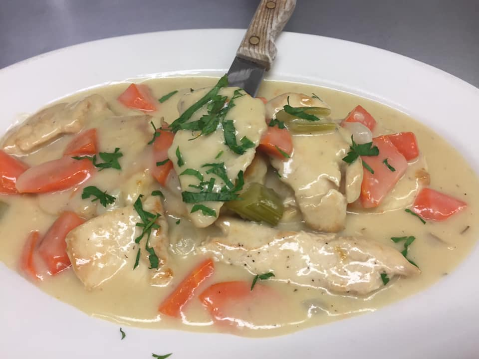 chicken, carrots, and celery in a cream sauce