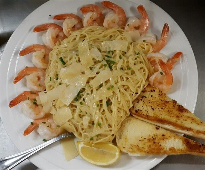 shrimp over linguine alfredo with shaved parmesan and garlic bread