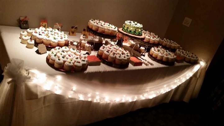 dessert table with cupcakes on it