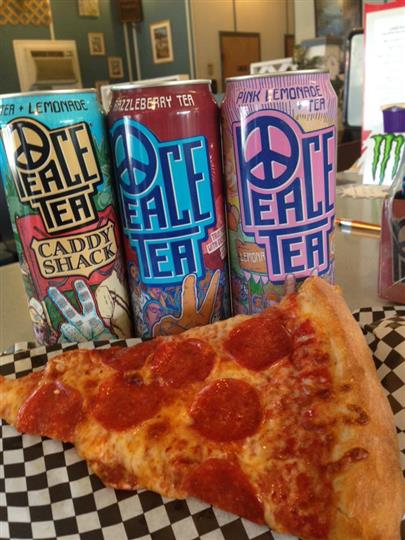 Pepperoni pizza slice next to 3 cans of peace tea