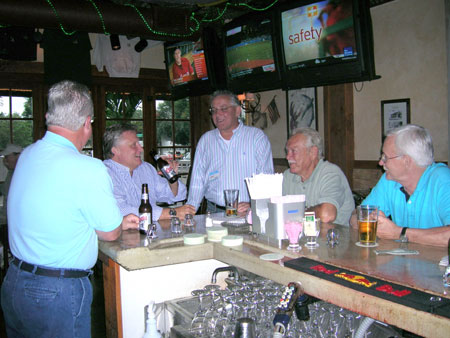 group of men at the bar
