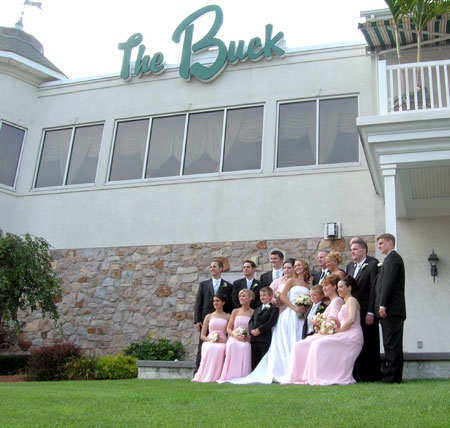 wedding party posing for picture