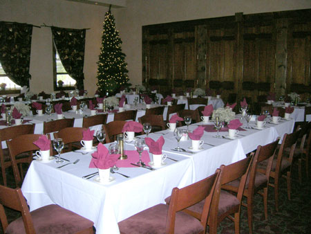 long decorated table with a christmas tree