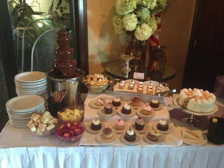 buffet table with various desserts