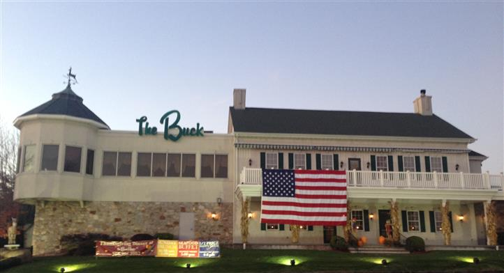 outside view of the buck with an american flag