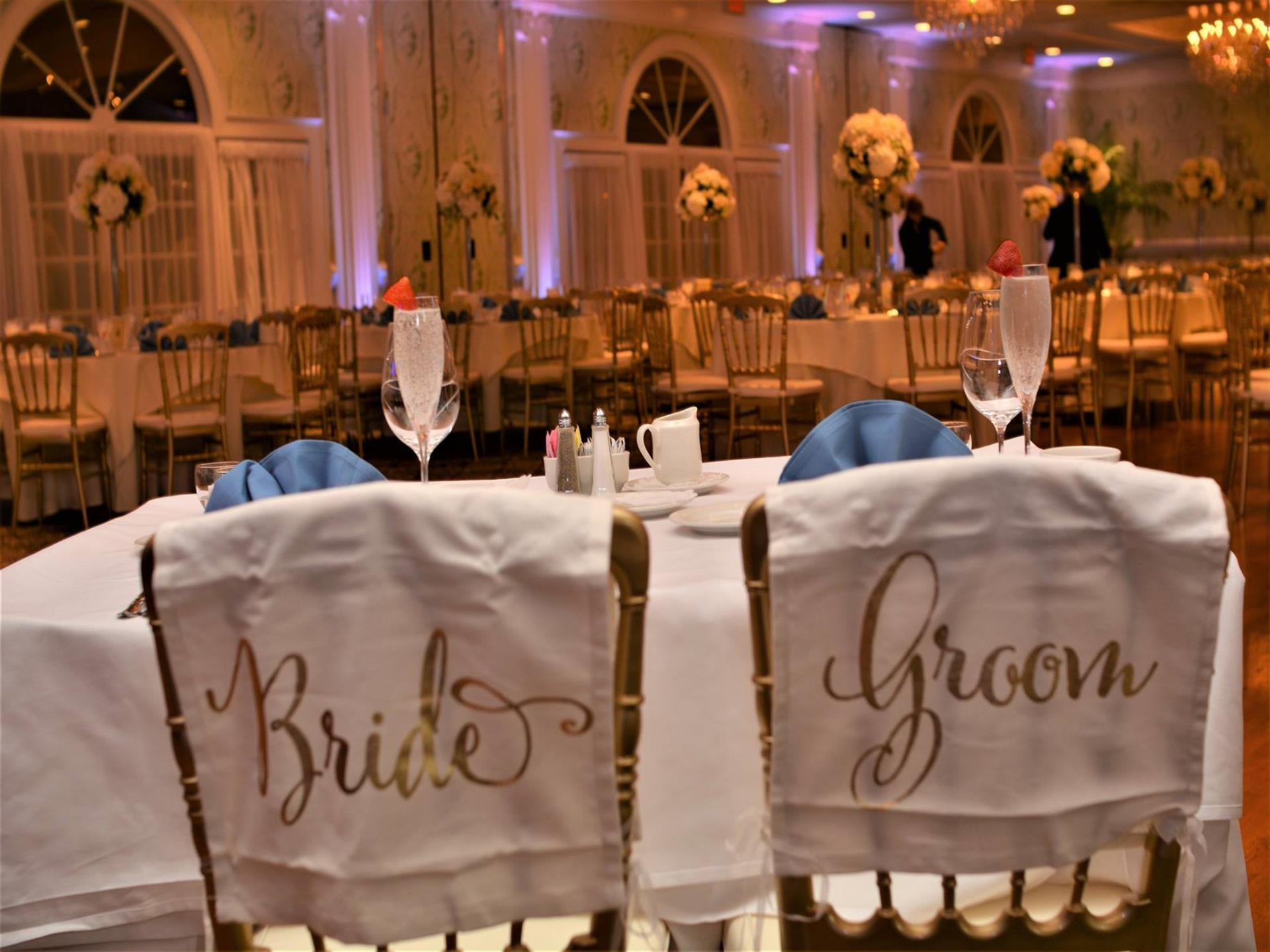 two chairs with bride and groom