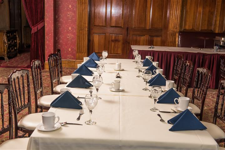 long table with napkins, plates, silverware