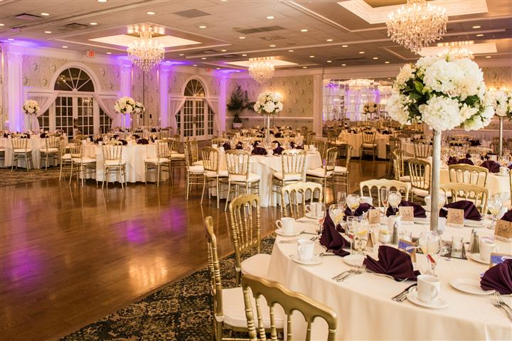 multiple decorated Wedding tables and chairs