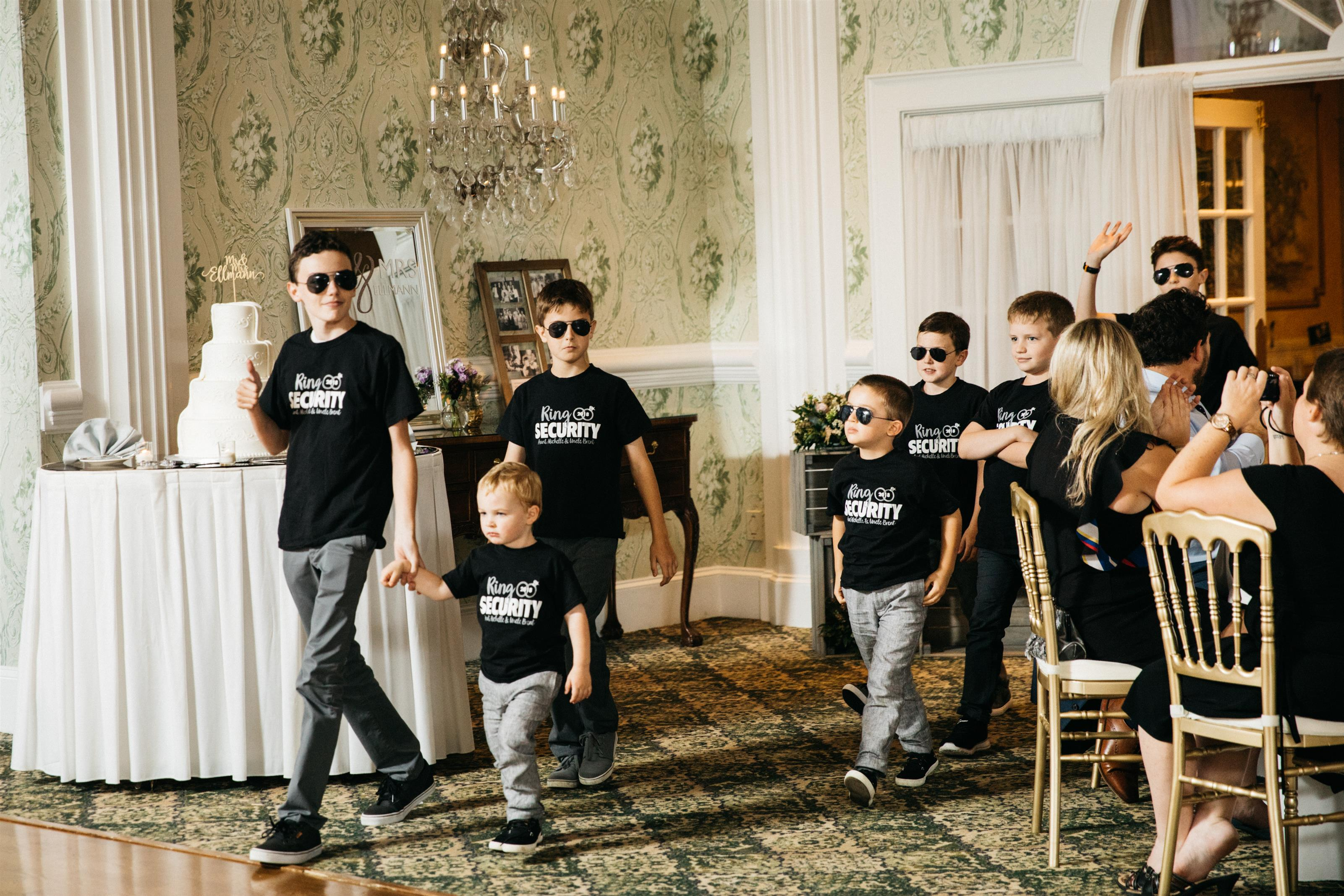 group of children walking in the venue in matching shirts
