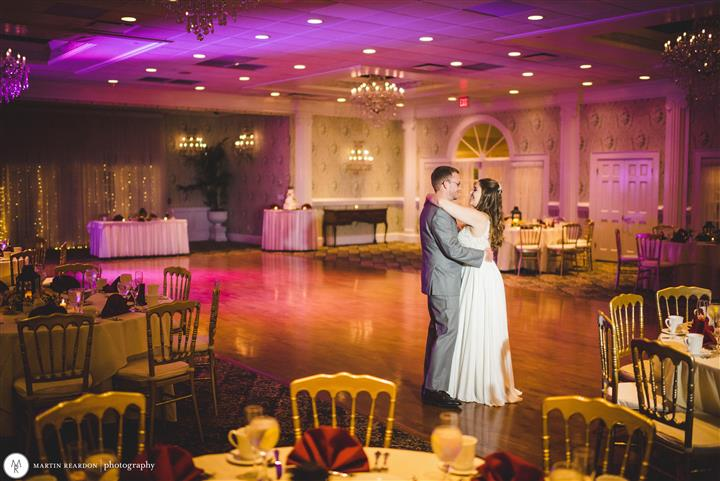 couple dancing in large ball room