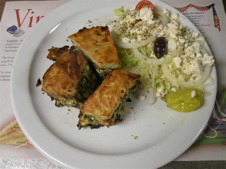 Spanakopita served with side salad and a pickle