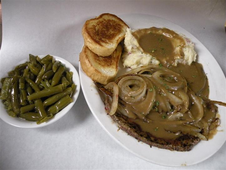 Filet topped with mushrooms and onions, with au jus, served with mushed potatoes, green beans and toasted bread