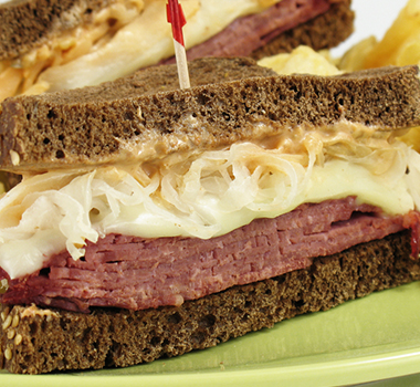 corn beef and cabbage sandwich on rye bread