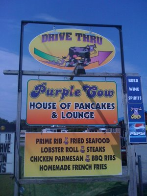 Exterior sign Drive Thru sign with Purple Cow House of Pancakes sign below it.