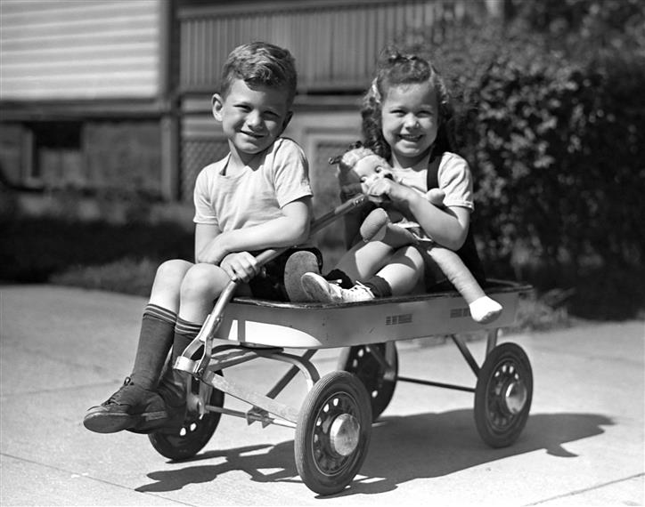 two kids in a wagon