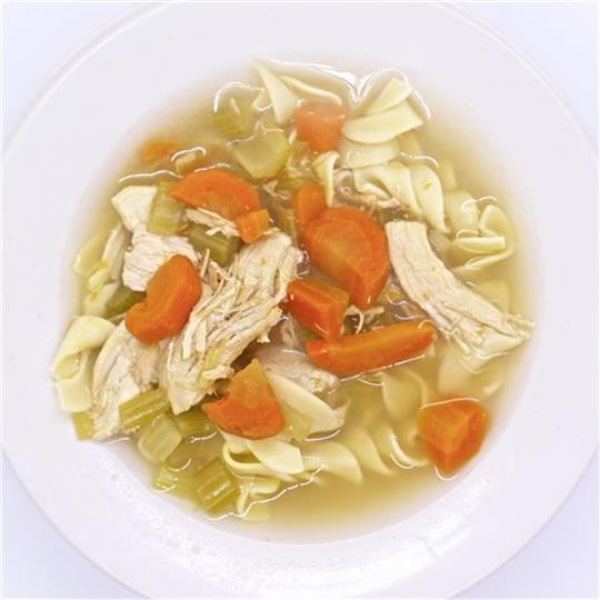 Chicken soup with carrot slices