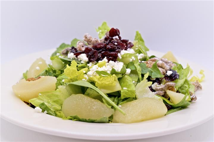 Salad topped with feta cheese and raisins