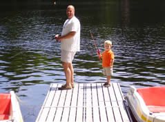 father and son fishing off a dock