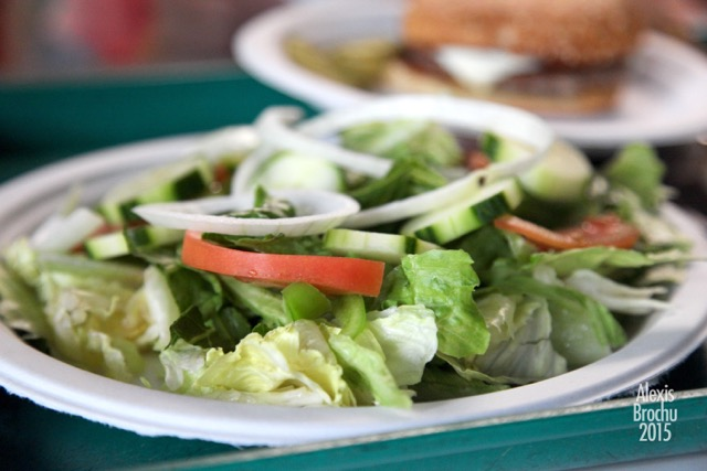 plate of garden salad with lettuce, cucumbers, onions and tomatoes