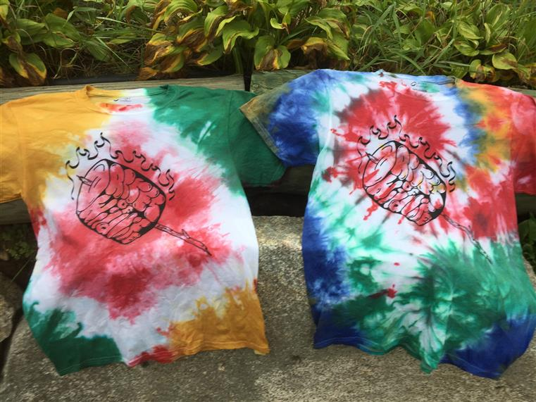tie dye t-shirts hanging to dry