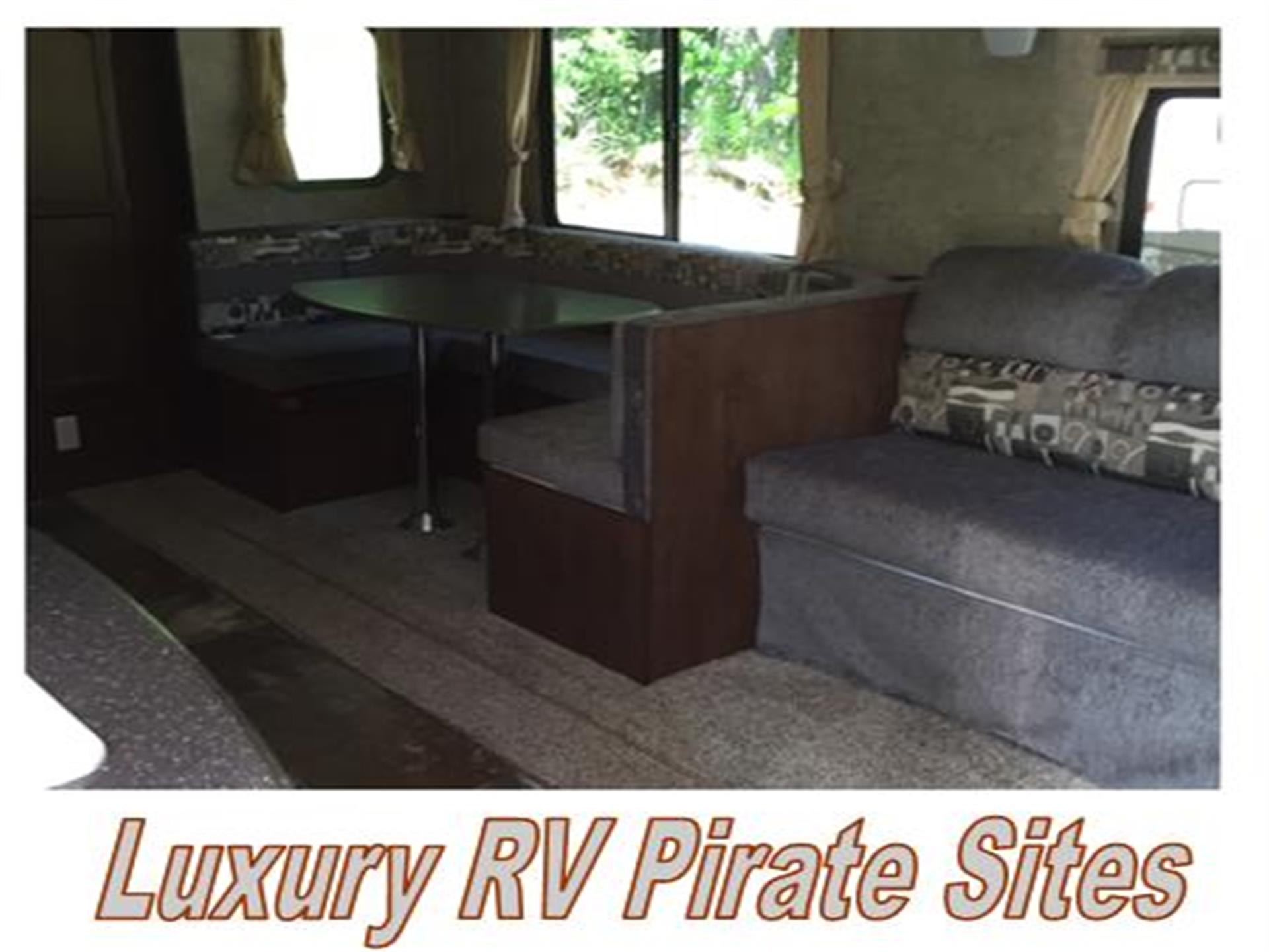 interior of a luxury rv rental with a table and couch
