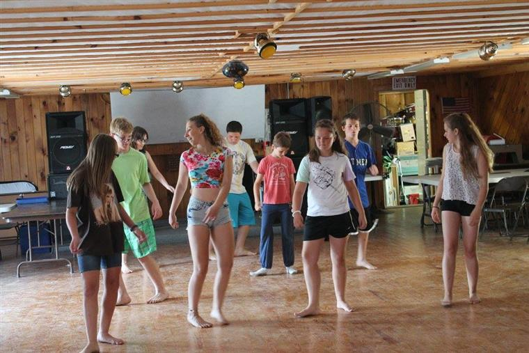 small group of kids learning to dance