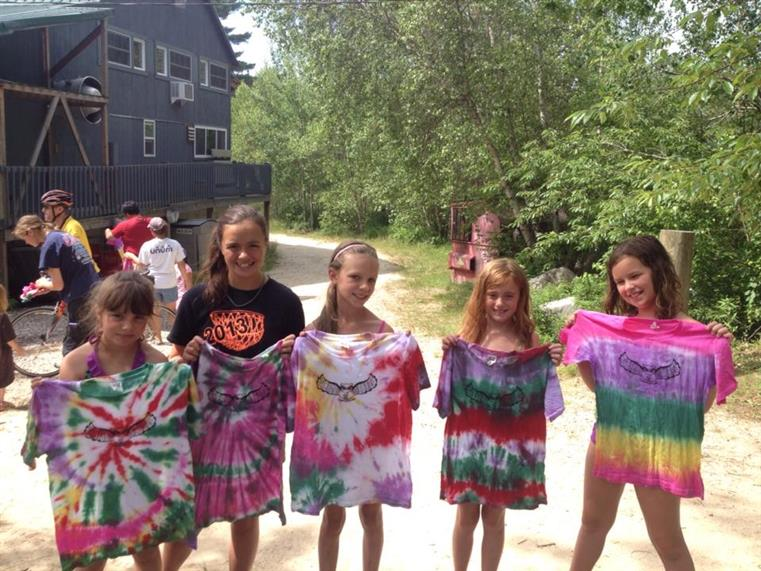 group of young girls showcasing their tie dye t-shirts