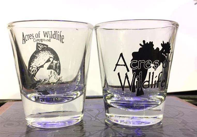 acres of wildlife shot glass displayed in a table