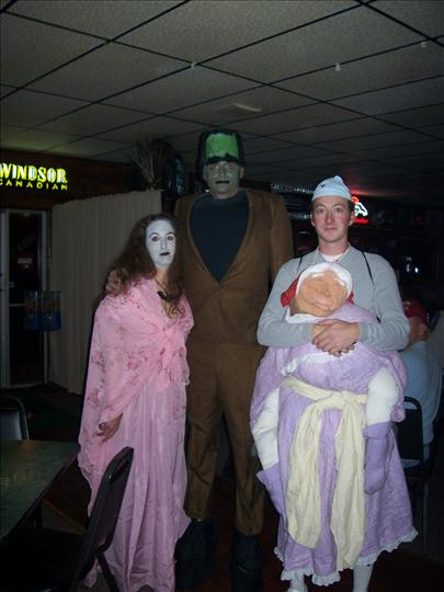 customers dressed up for a halloween theme party