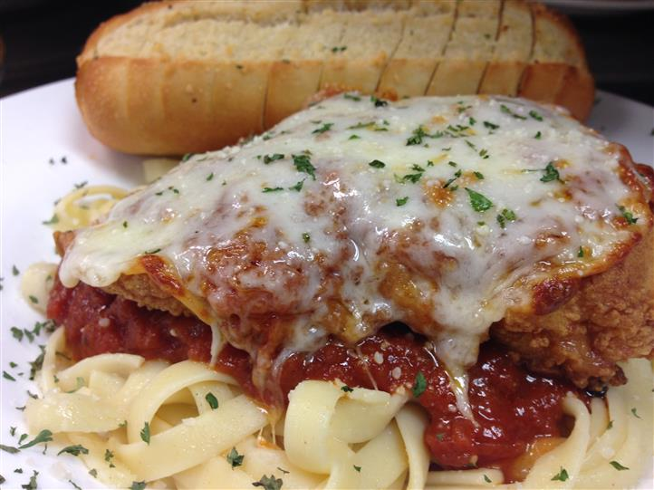 chicken parm with pasta and garlic bread