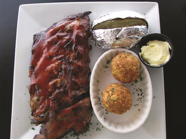 bbq ribs with baked potato and hush puppies