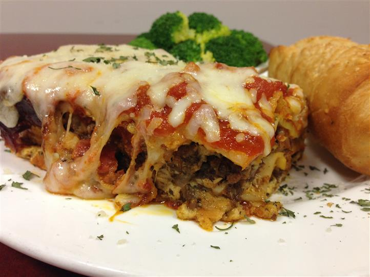 slice of beef lasagna with vegetables